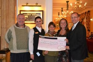Chris, Jeannet and Emma Savory were presented a cheque by 'The Hydro Team' for Para-Monte.